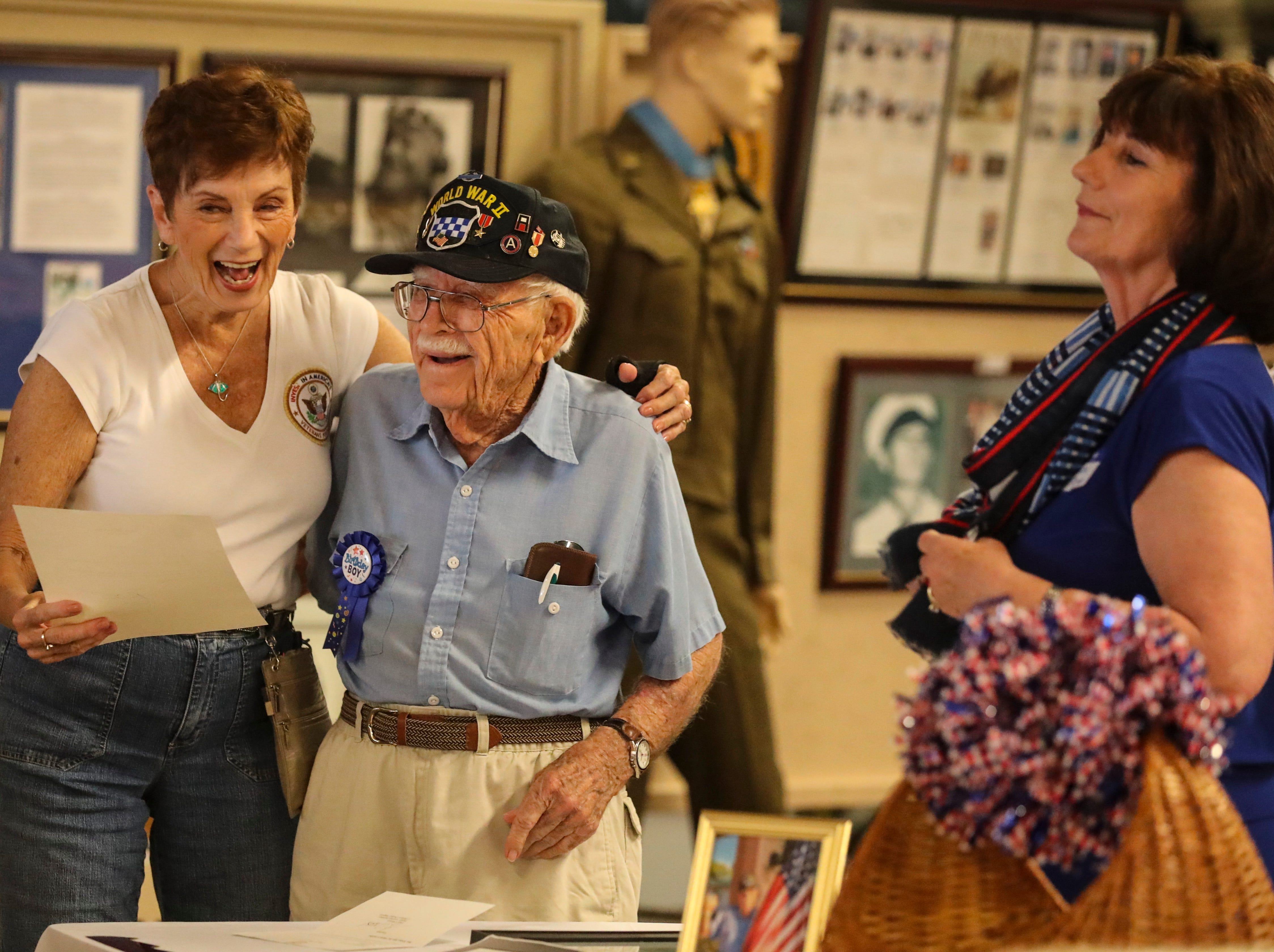 William Workman turned 97. His family and friends had a surprise birthday party at the Southwest Florida Military Museum in Cape Coral. Bill was with the 99th Division that landed in Europe on Nov. 17, 1944, then shipped to Bastogne. Mary Anne Passatore, of Fort Myers and a volunteer with the museum, shares a laugh with Bill before she reads a letter from Governor DeSantis. Wanda Stump looks on.
