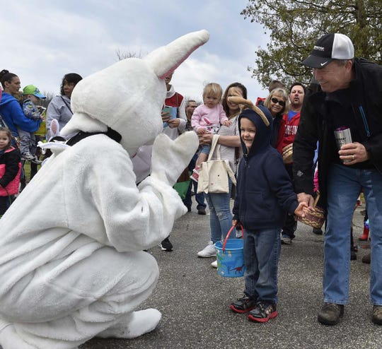The Easter Bunny greets Billy Hoff of Pecatonica, Ill., and Billy's grandfather Bill Peters of Hudson during a past Easter egg hunt at Waterfront Park in Sister Bay.