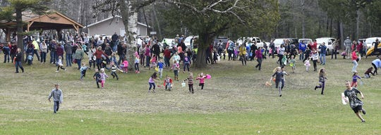 Easter egg hunters take off in pursuit of plastic candy-filled eggs at a past egg hunt at Fitzgerald Park in Ellison Bay.