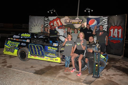 De Pere's Johnny Whitman celebrates with family and friends after his fifth straight IMCA modified track championship at 141 Speedway in Francis Creek.