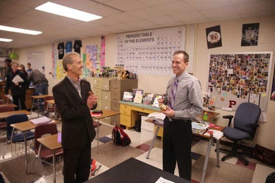 Pulaski High School teacher Jeffrey Gosse receives his Golden Apple award on Feb. 14. Gosse is a chemistry and science teacher.