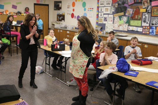 Pulaski Community Middle School teacher Lindsey Przybylski receives her Golden Apple award on Feb. 14. Przybylski teaches art education.