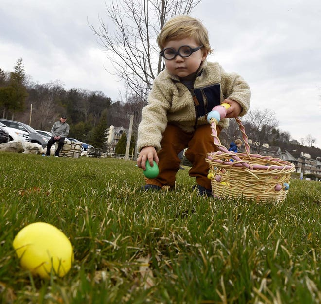 Liam Hockers of Milwaukee collects eggs during a past Easter egg hunt at Waterfront Park in Sister Bay.