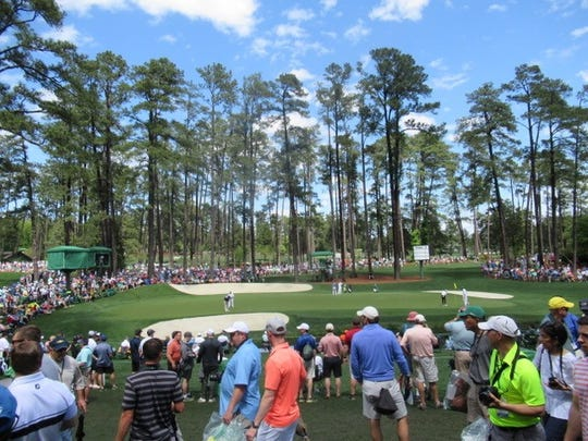 Even the practice round at the Masters draws a crowd to Augusta National.