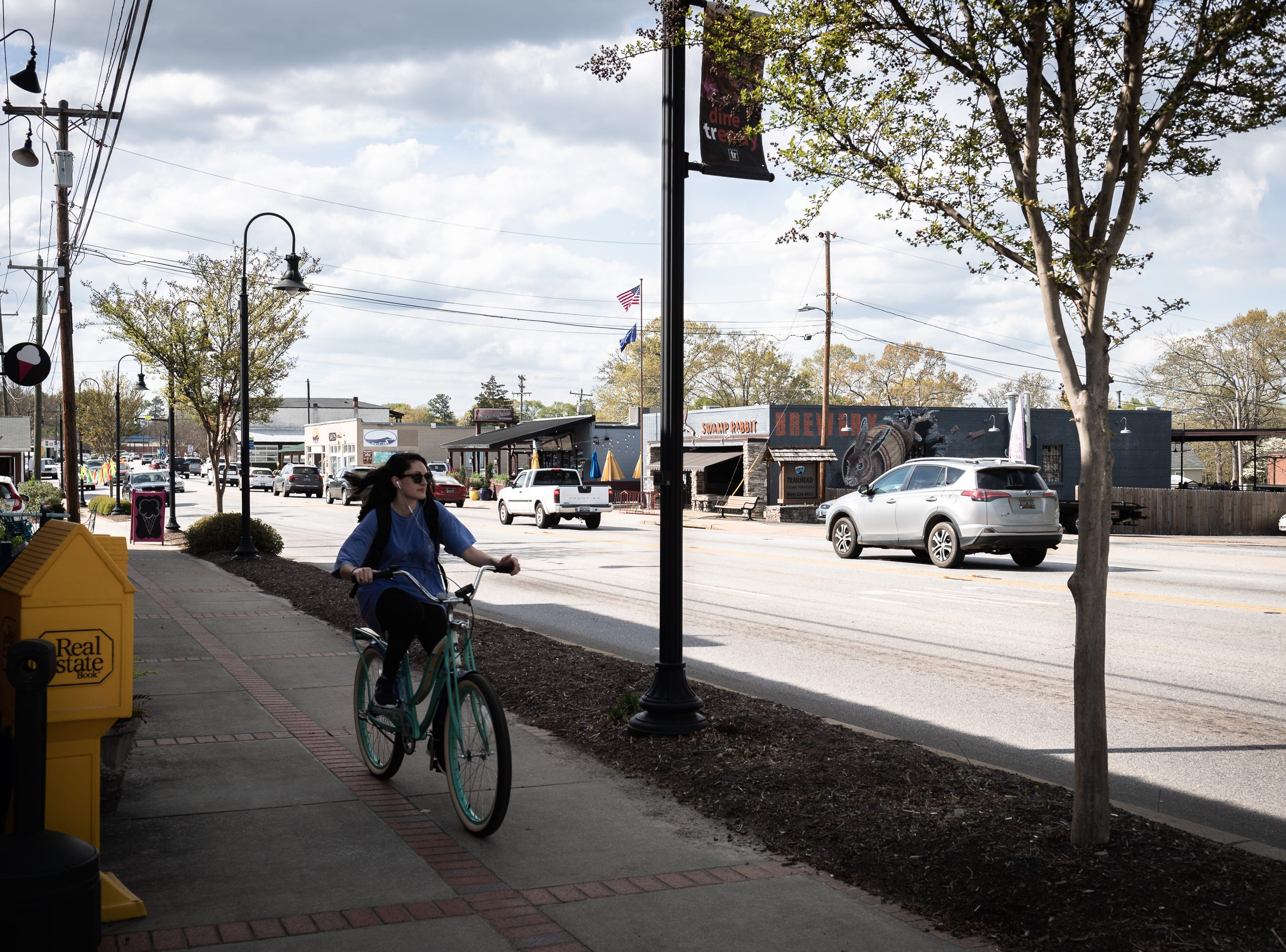 A cyclist travels down South Main Street in Travelers Rest Apr. 11, 2019.