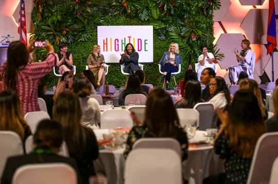 Stacie Krajchir-Tom, right, and panelists are applauded during a candid conversation during the second Hightide Woman's Summit, hosted by the Guam Women's Chamber of Commerce, at the Dusit Thani Guam Resort in Tumon on Friday, April 12, 2019. The panelists, from left: Jen Bilik, Knock Knock CEO; Megan Villa, SVN Space co-founder; Freya Estreller, Cool Haus co-founder & Tea Drops head of operations, seated with her wife, Natasha Case and Paco de Leon, founder of the The Hell Yeah Group financial firm.