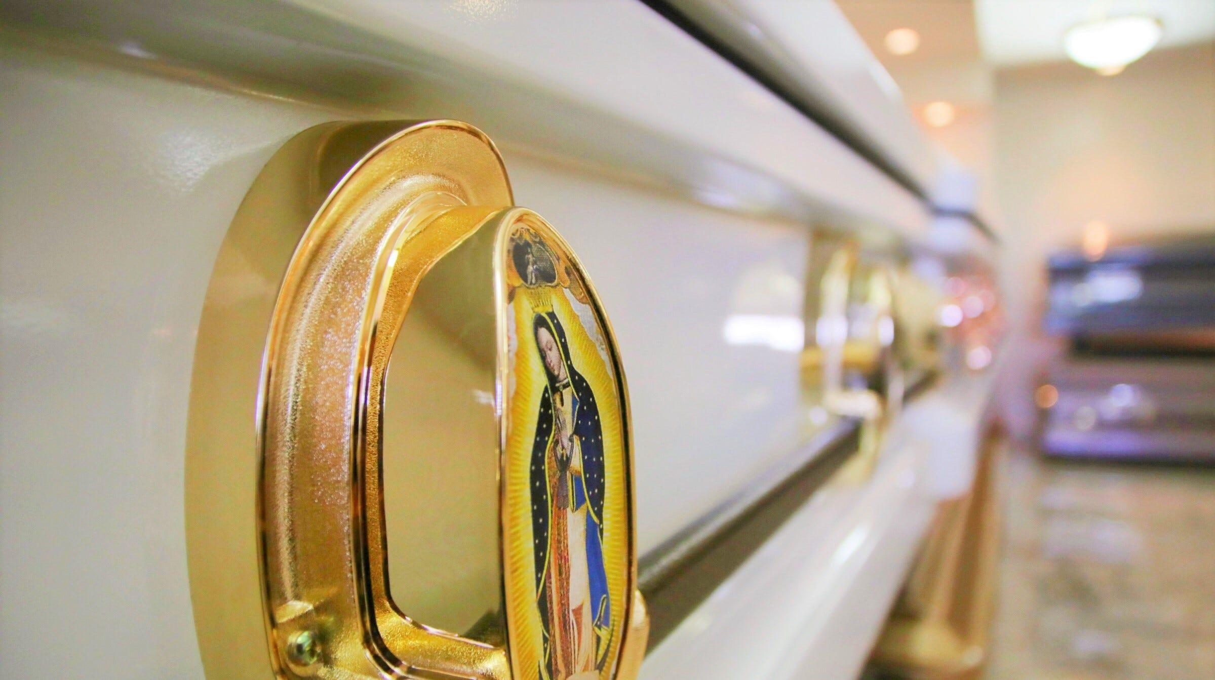 a4653bb8 9742 487a 927d aebb50c03a03 Decal of a casket at Our Lady of Peace in Barrigada 2 JPG?crop=2399,1343,x0,y0&width=2399&height=1343&format=pjpg&auto=webp.