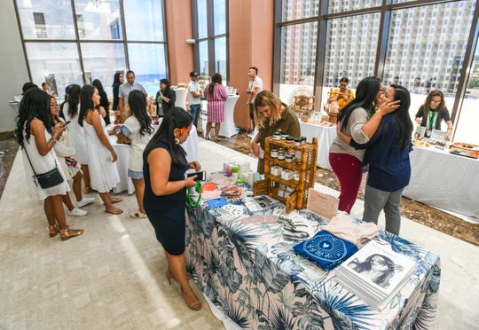 Attendees browse through products and services offered by pop up shop vendors during the second Hightide Woman's Summit, hosted by the Guam Women's Chamber of Commerce, at the Dusit Thani Guam Resort in Tumon on Friday, April 12, 2019.