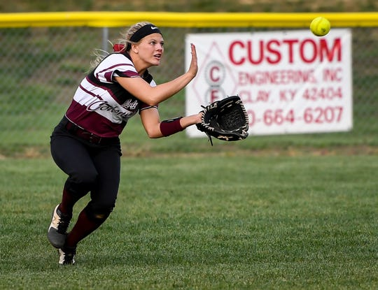 Henderson County's Kaytlan Kemp (1) make a catch in the outfield as the Lady Trojans play the Lady Colonels in Dixon Thursday evening, April 11, 2019.