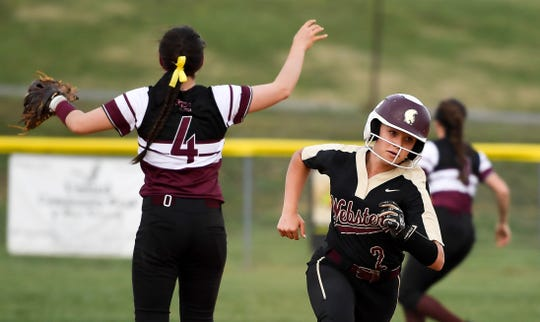 Webster County's Taylor Thomas rounds second base toward third in the sixth inning as the Lady Trojans play the Lady Colonels in Dixon Thursday evening, April 11, 2019.