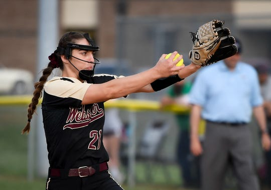 Webster County pitcher Karlie Keeney winds up to throw as the Lady Trojans play the Lady Colonels in Dixon Thursday evening, April 11, 2019.