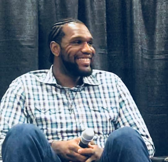 "Greg Oden smiles during a panel called ""When Sports Ends"" at Ohio State University April 11, 2019."