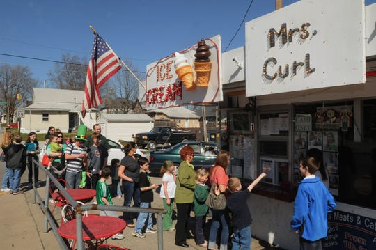 As the afternoon turns out to be mild, people gather to order ice cream at Mrs. Curl, 259 S. Meridian Street in Greenwood on March 17, 2010.