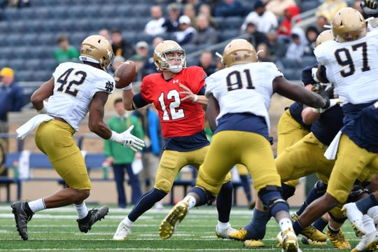 Notre Dame Fighting Irish quarterback Ian Book (12) throws in last year's Blue-Gold Game at Notre Dame Stadium.