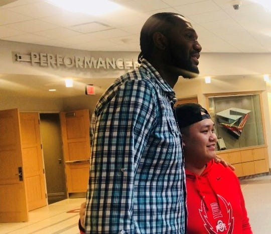 Greg Oden poses for a photo with a student at Ohio State University April 11, 2019.