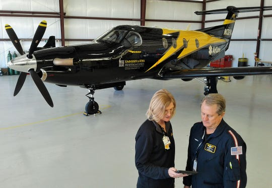 Diane Lamb and pilot Kenneth Chaplin talk shop in front of the sleek, Pilatus PC-12 turboprop which was recently placed into service to handle long-distance medical transports for UICC. Chaplin, a veteran of the commercial airline industry, has more than 30,000 flight hours and works 12-hour shifts at this hangar in Iowa City.