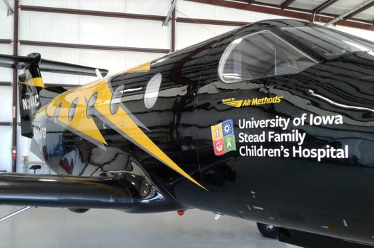 Hawkeye colors and the University of Iowa Stead Family Children's Hospital logo are part of the unique paint job identifying the new AirCare plane.