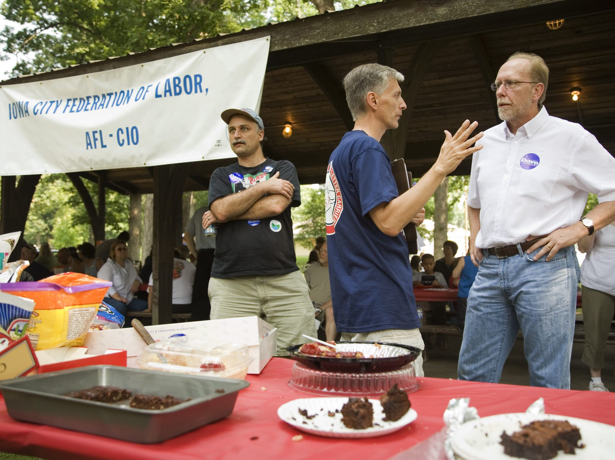 Rep. Dave Loebsack, D-Iowa (right) talks to Jim Beach at the Iowa City Federation of Labor's, Labor Day picnic at City Park in Iowa City, Iowa, on Sept. 1, 2008.