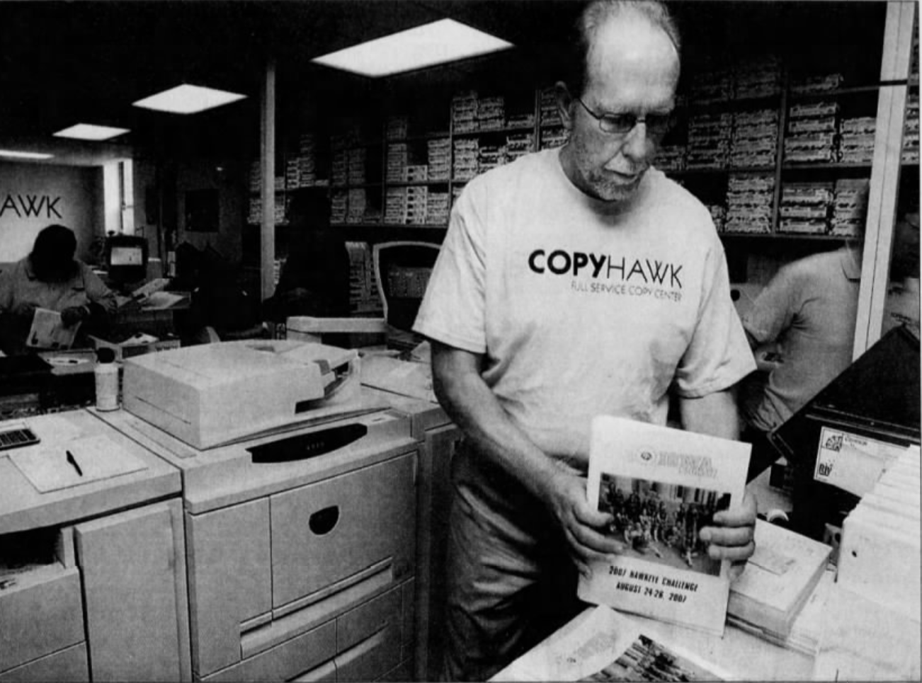 """Freshman Rep. Dave Loebsack, D-Mount Vernon, straightens a stack of copies while working Thursday, Aug. 23, 2007, at the CopyHawk center in the Iowa Memorial Union. The Congressman has been visiting businesses in his district, trying out various jobs for his """"take your congressman to work week."""""""