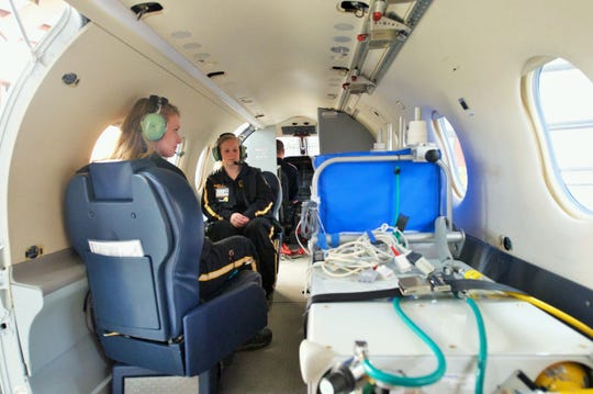 Critical care medical staff have more room to work on patients inside the fixed wing craft, as demonstrated by nurses Hana Molinari (left) and Kate Shelangoski in this photo.