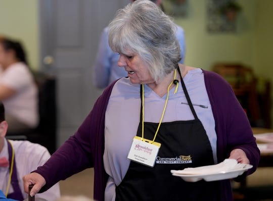 Dream Center Executive Director Gail Gustafson pours coffee for a customer at the 2019 March of Dimes Breakfast for Babies, Friday, April 12, at The Bakers' Rack.