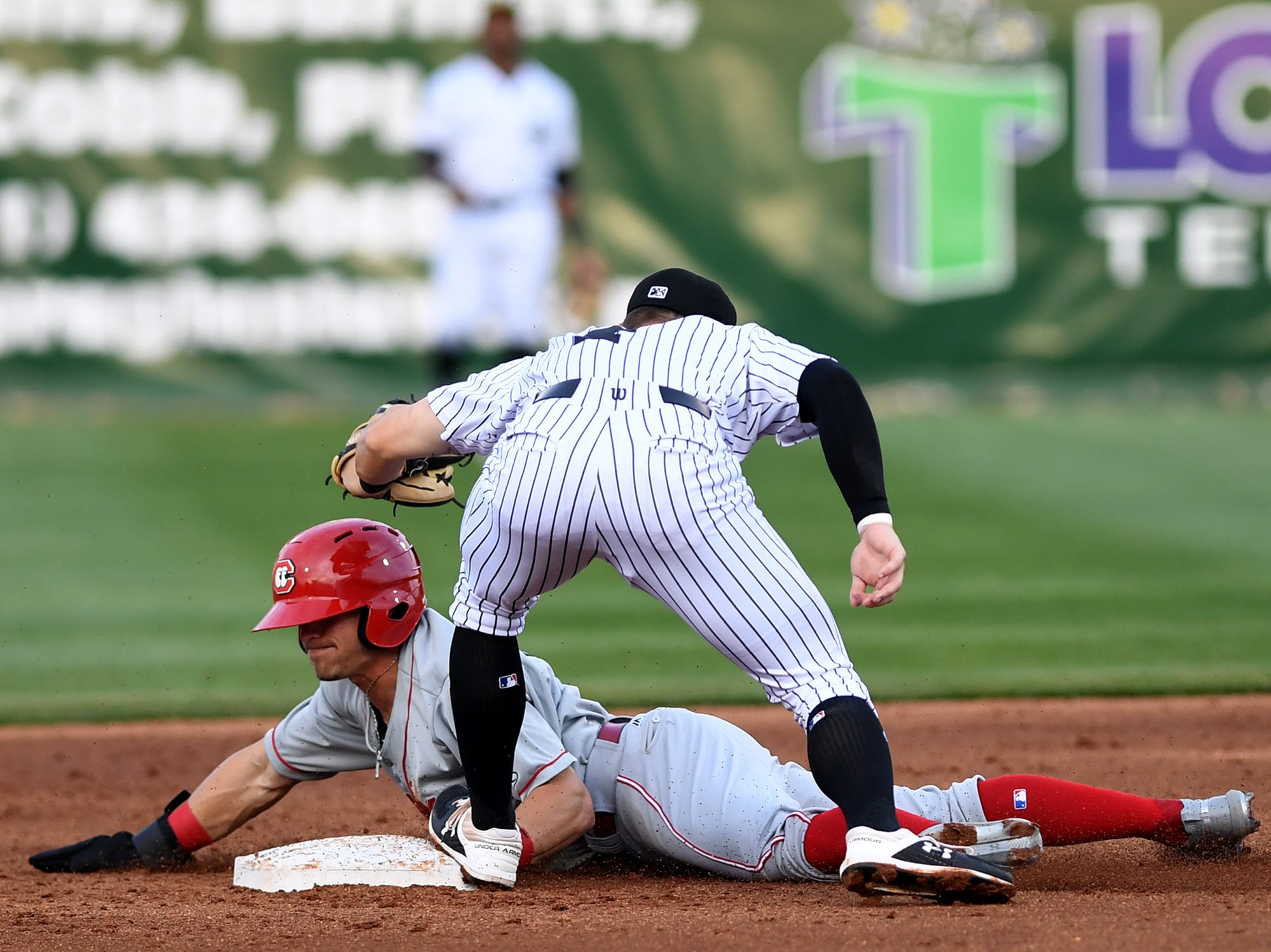 Generals' Andy Young tags Chattanooga Lookouts' TJ Field during their game, Thursday, April 11.