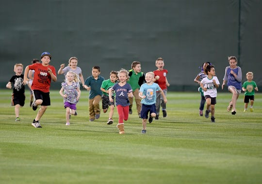 About 20 children participated in the Kids' Fruit Run between innings of the Generals' game against the Chattanooga Lookouts on Thursday.