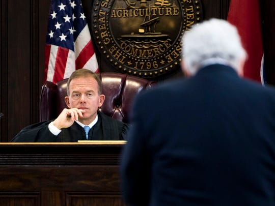 Eighth Judicial District Circuit Court Judge John D. McAfee listens as attorney Herbert S. Moncier, right, speaks during a hearing in Claiborne County Circuit Court in New Tazewell, Tenn., on Friday, April 12, 2019.