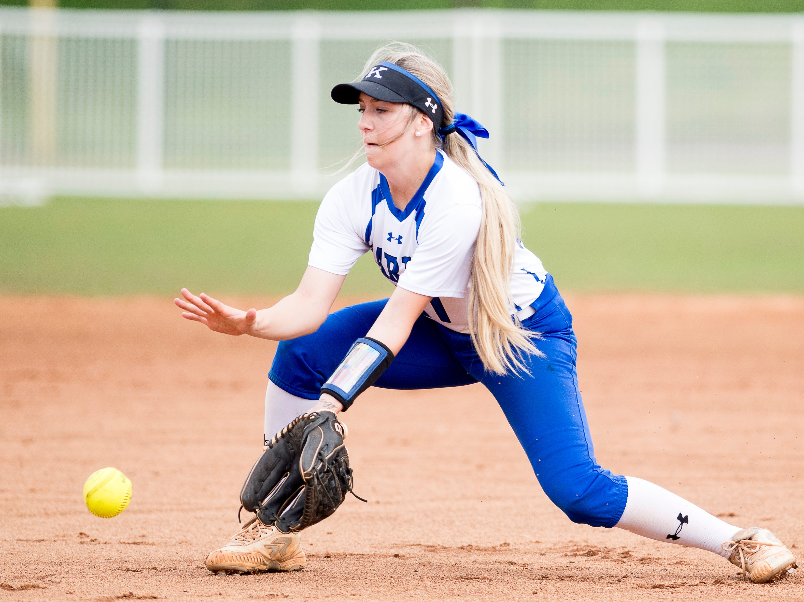 Karns' Jennifer Bezark (27) catches a ground ball during a softball game between Catholic and Karns at Caswell Park in Knoxville, Tennessee on Friday, April 12, 2019.
