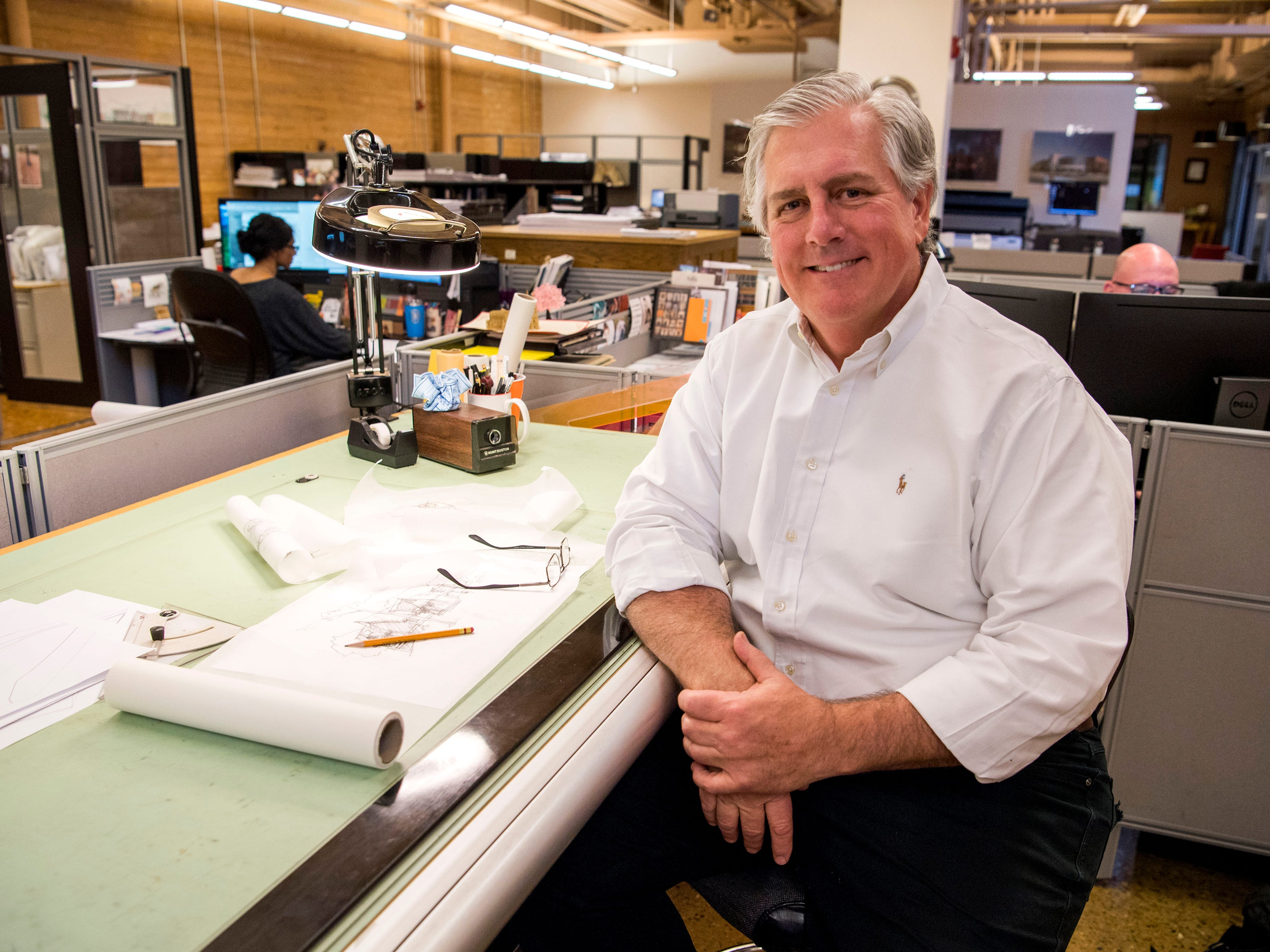 Johnson Architecture's Daryl Johnson works at his drawing board at the firm's office at Cherokee Mills in Knoxville on Tuesday, April 2, 2019.