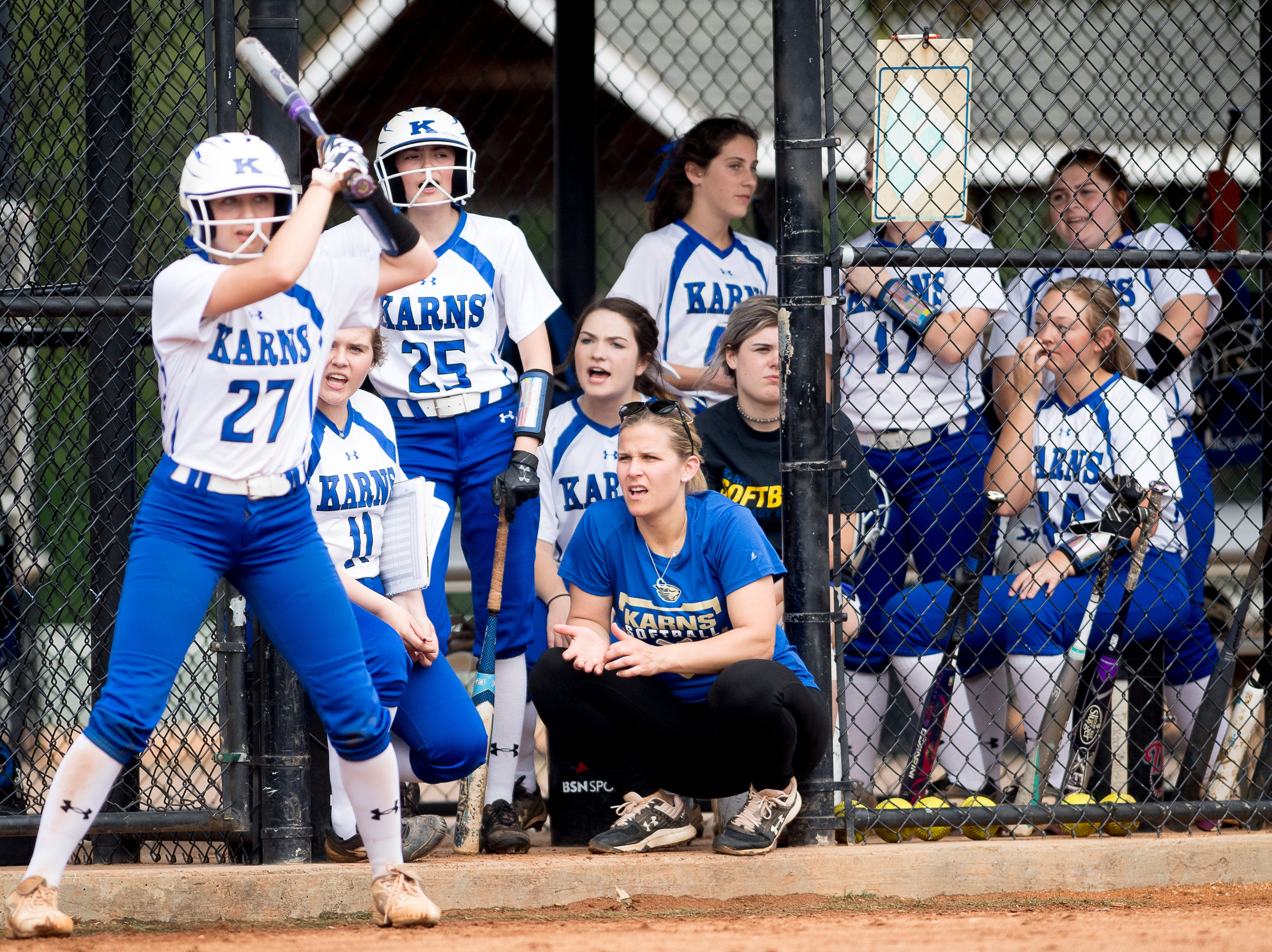 Karns cheers from the dugout during a softball game between Catholic and Karns at Caswell Park in Knoxville, Tennessee on Friday, April 12, 2019.