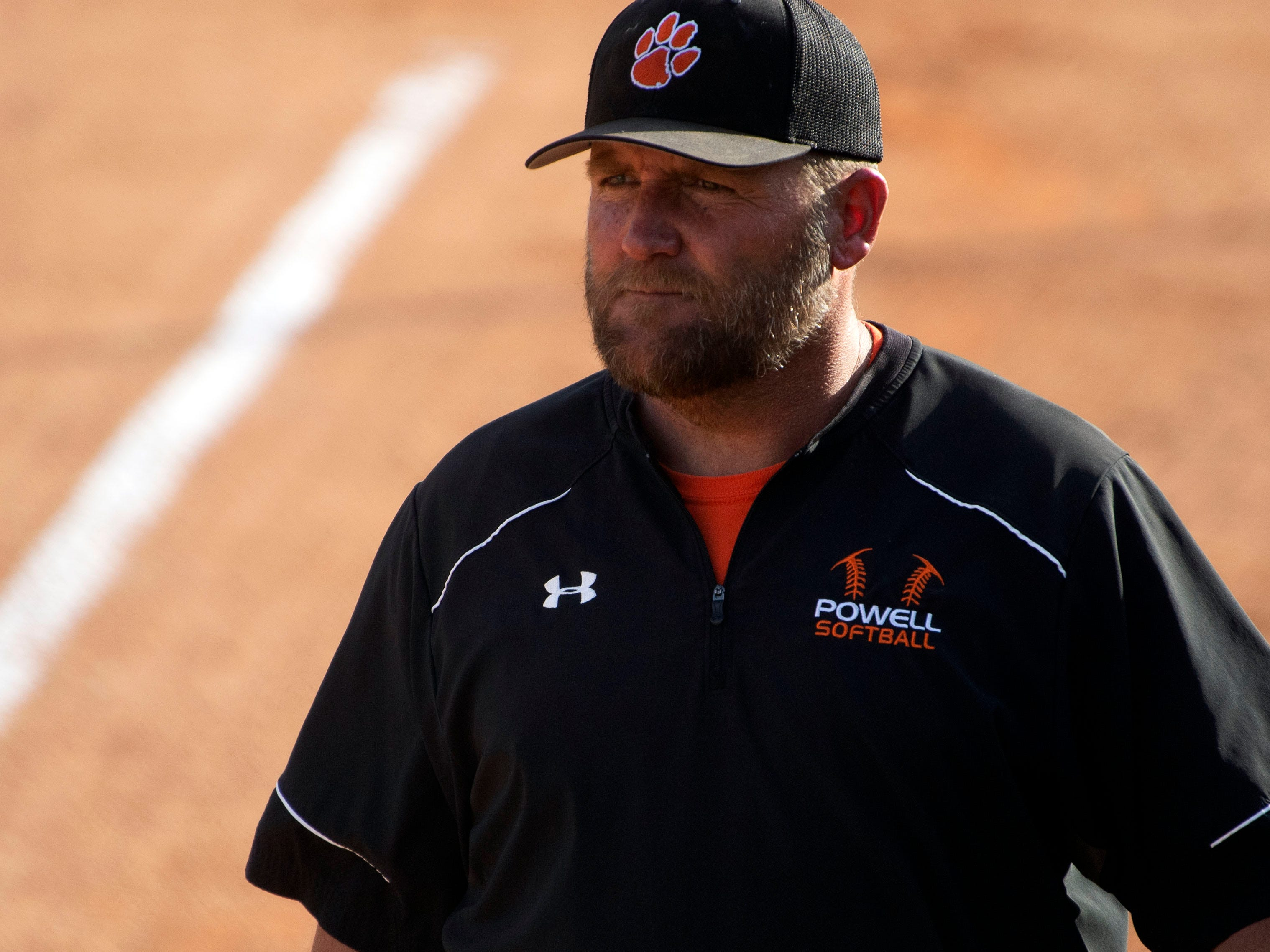 Powell softball coach Jeff Inman during the team's first game at home on Thursday, April 11, 2019 after heavy rains destroyed their home field.