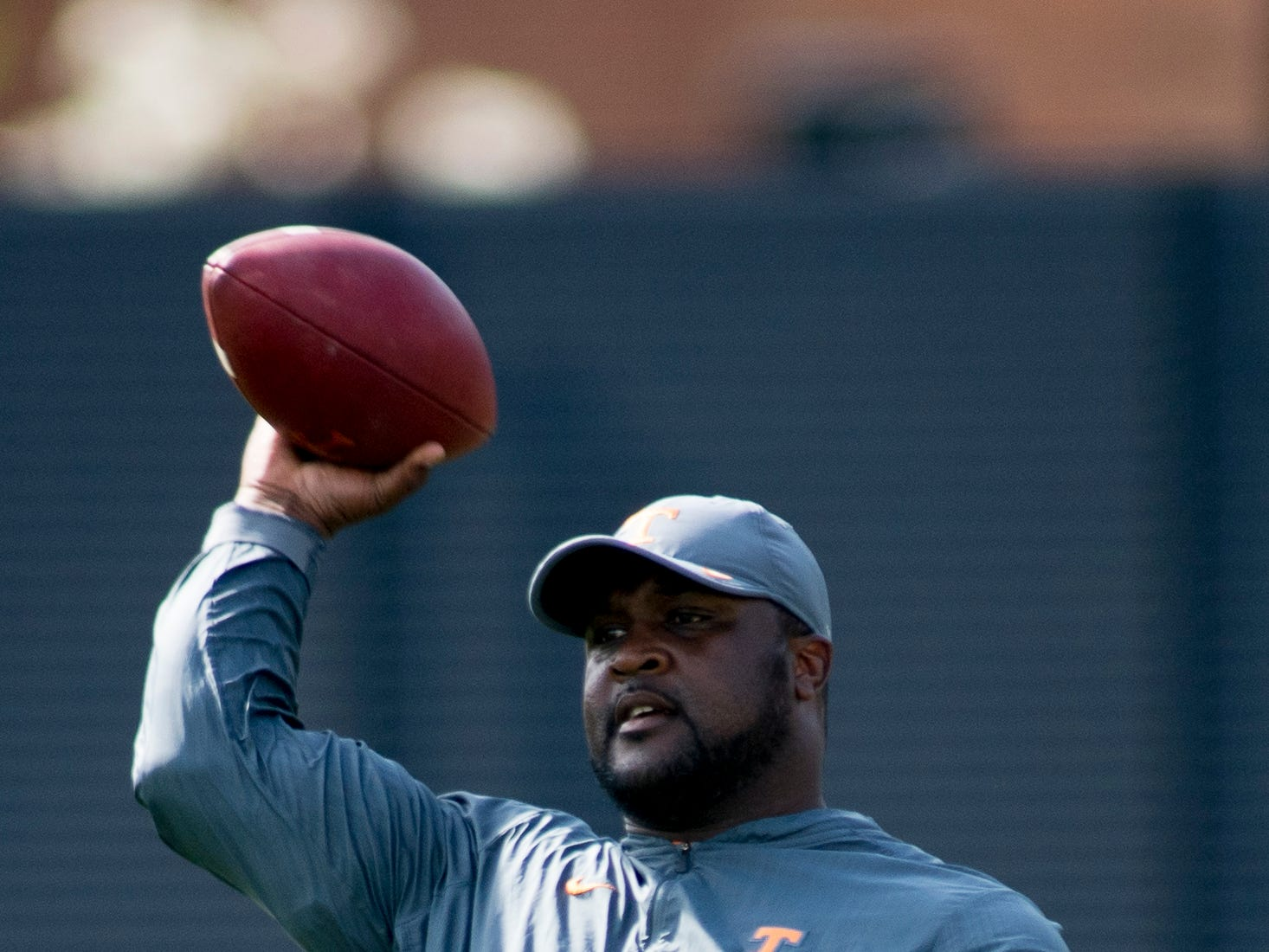 Tennessee Assistant Head Coach Tee Martin throws a pass during Tennessee spring practice at Haslam Field in Knoxville, Tennessee on Thursday, April 11, 2019.