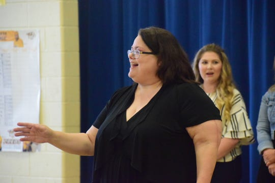 "Third-grade teacher Sheila Earl leads the class in singing ""Rocky Top"" during her retirement assembly held at Karns Elementary School Tuesday, April 9, 2019."