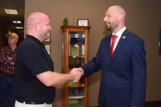 Rob Voigt thanks his boss Grant Whitfield, left, for his support during a reception announcing Voigt's candidacy for Knox County Commission District 6 in Hardin Valley Monday, April 8.
