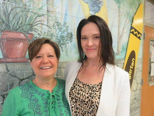 Honored teacher Lisa Wilkins, left, and Rocky Hill instructional coach Rebecka Folks