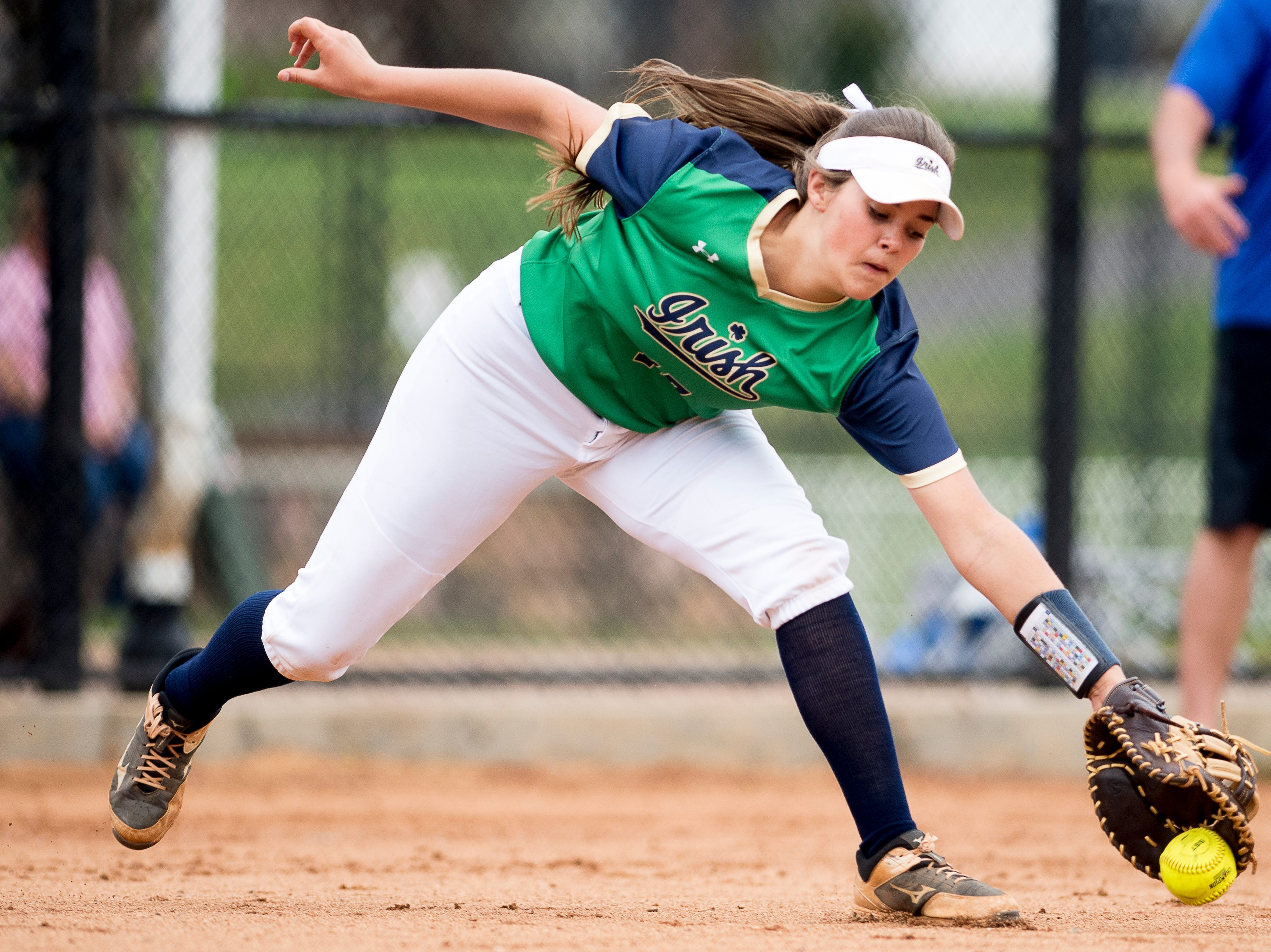 Catholic's Anne Carter (17) reaches for a ground ball during a softball game between Catholic and Karns at Caswell Park in Knoxville, Tennessee on Friday, April 12, 2019.