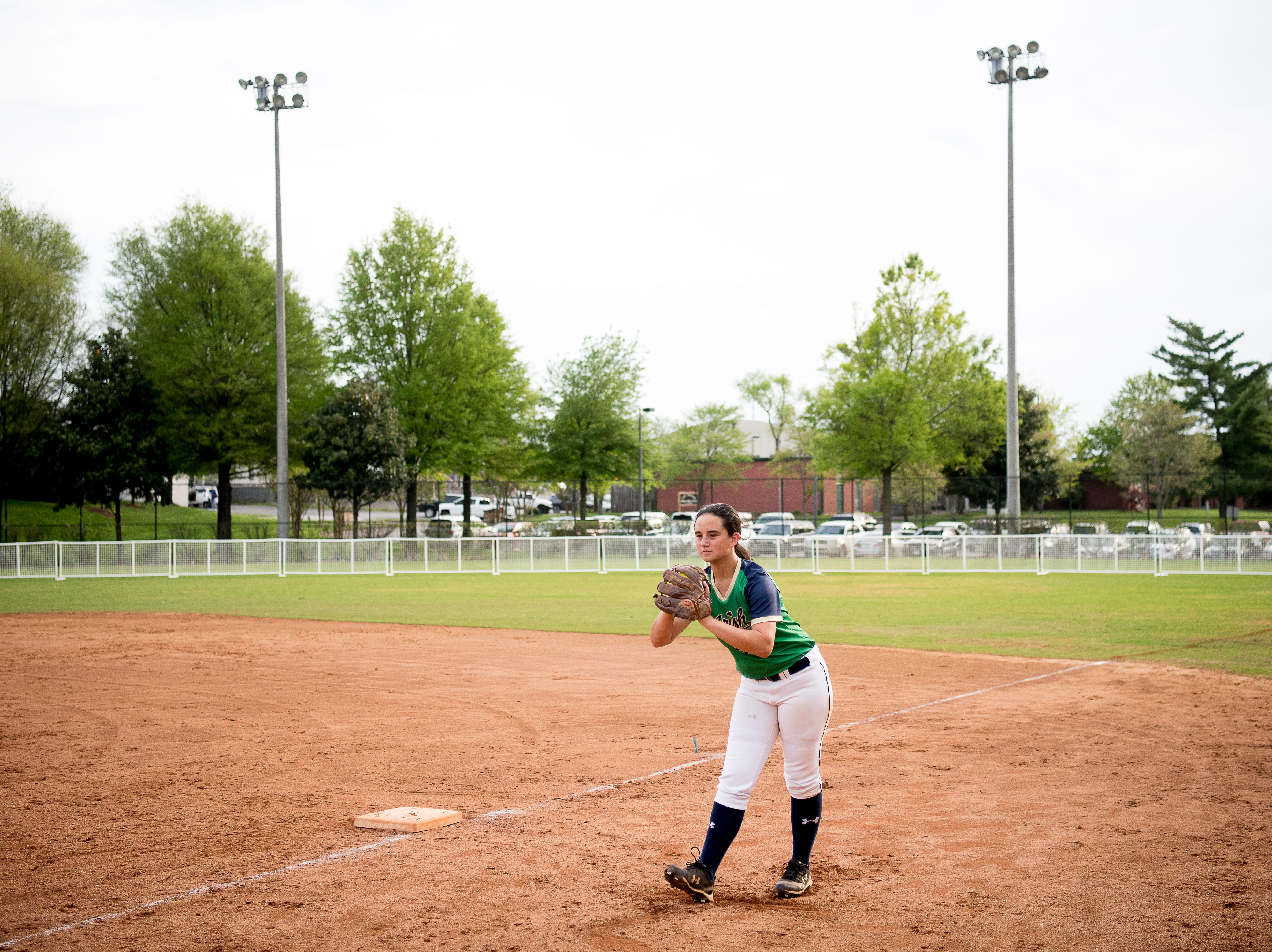 Catholic's Emma Schaad (55) warms up before a softball game at Caswell Park in Knoxville, Tennessee on Friday, April 12, 2019.
