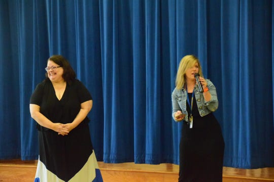 Sheila Earl is all smiles as fellow teacher Marissa Butler announces Earl's retirement during her retirement assembly held at Karns Elementary School Tuesday, April 9.