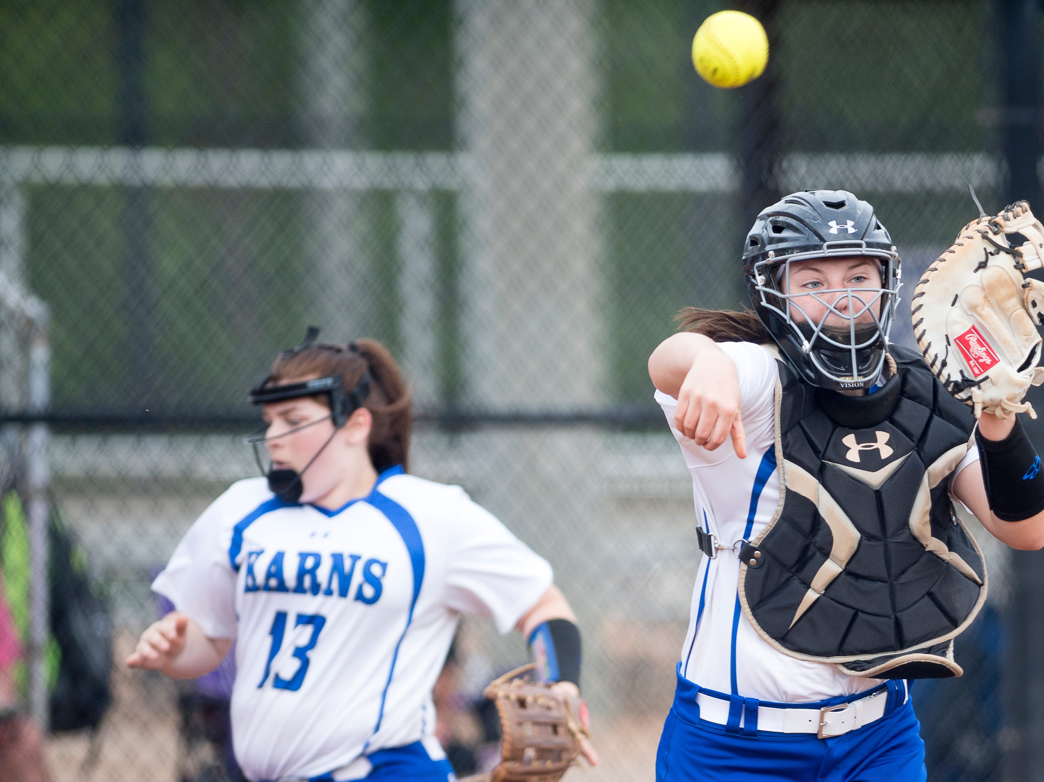 Karns' Lexie Baker (00) throws the ball to first during a softball game between Catholic and Karns at Caswell Park in Knoxville, Tennessee on Friday, April 12, 2019.