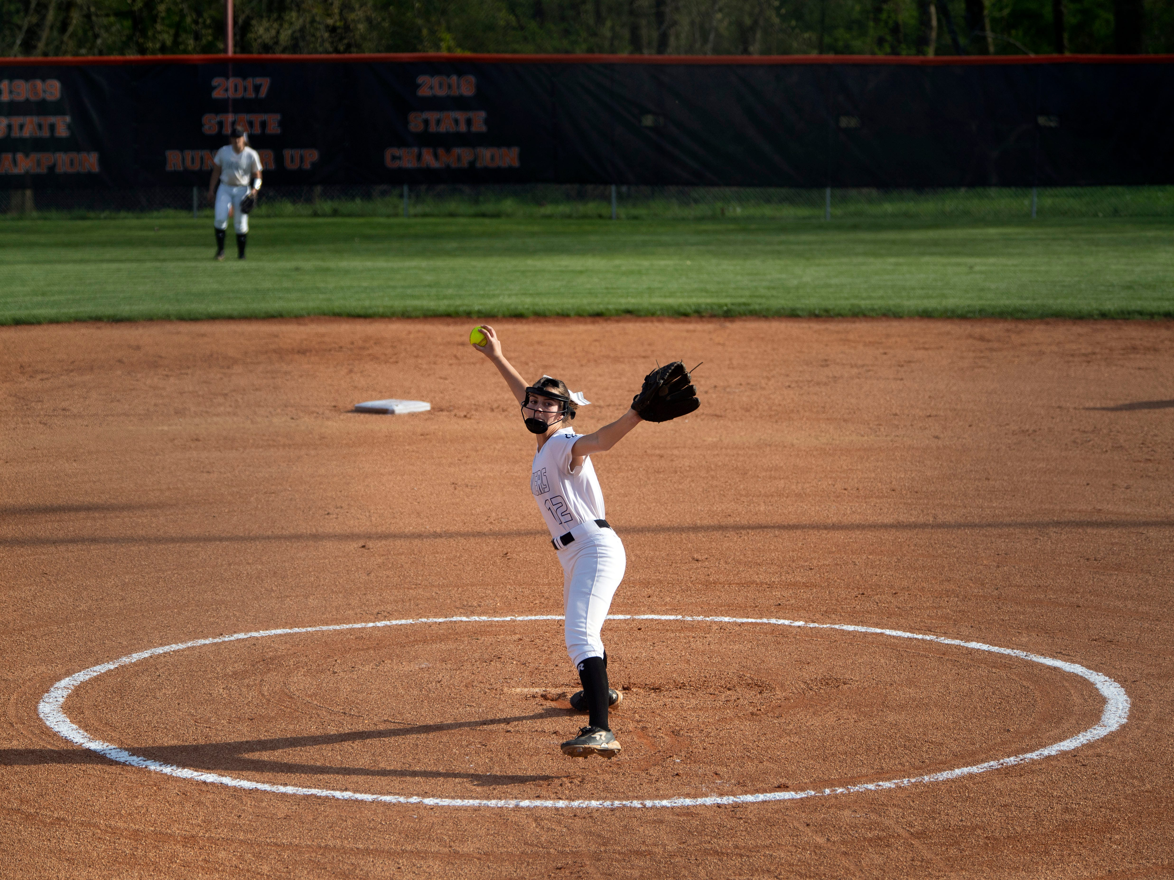 Powell's Allison Farr (12) pitches in the game against Central on Thursday, April 11, 2019.