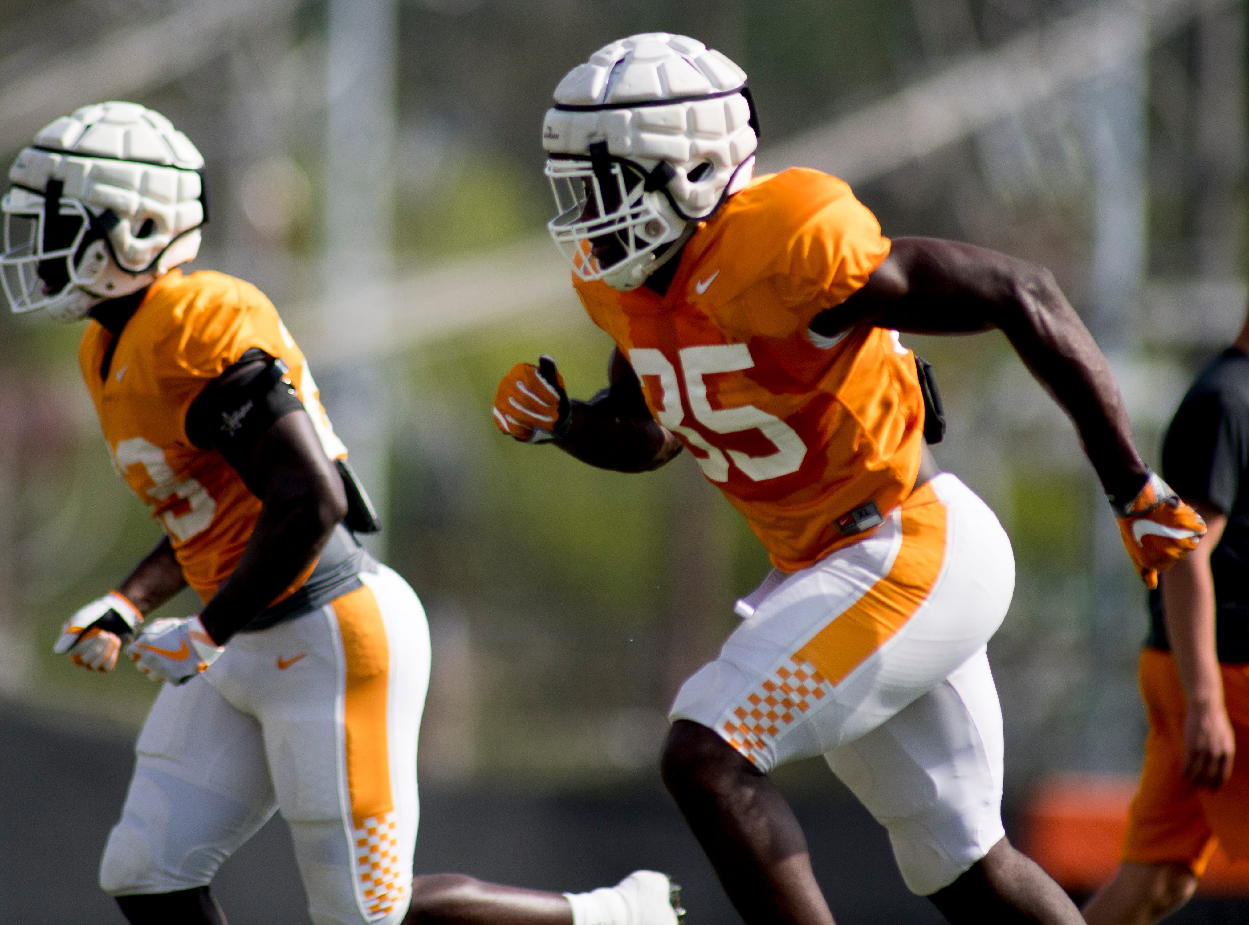 Tennessee's Daniel Bituli (35) runs through a drill during Tennessee spring practice at Haslam Field in Knoxville, Tennessee on Thursday, April 11, 2019.