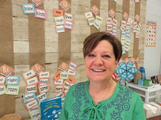 Lisa Wilkins, the winner of the Rotary Club of Knoxville's Teacher of the Year for the elementary school division, stands inside her first grade classroom at Rocky Hill Elementary on April 11.