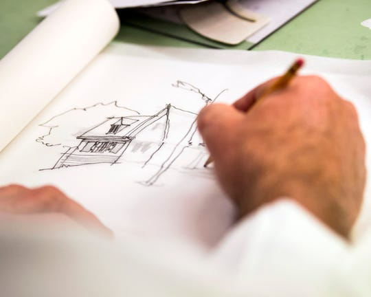 Johnson Architecture's Daryl Johnson sketches a house design at the firm's office at Cherokee Mills in Knoxville on Tuesday, April 2, 2019.