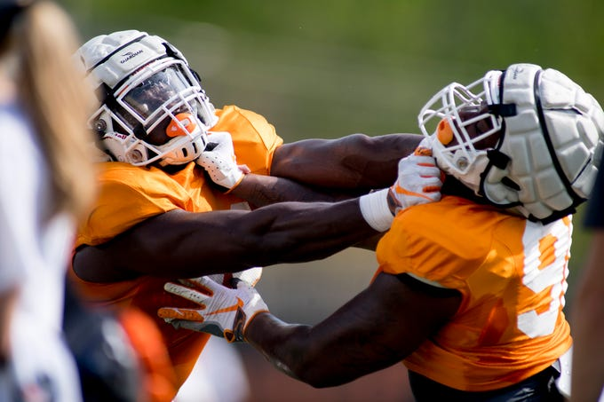 Tennessee's Matthew Butler (94) and Aubrey Solomon (98) drill together during Tennessee spring practice at Haslam Field in Knoxville, Tennessee on Thursday, April 11, 2019.