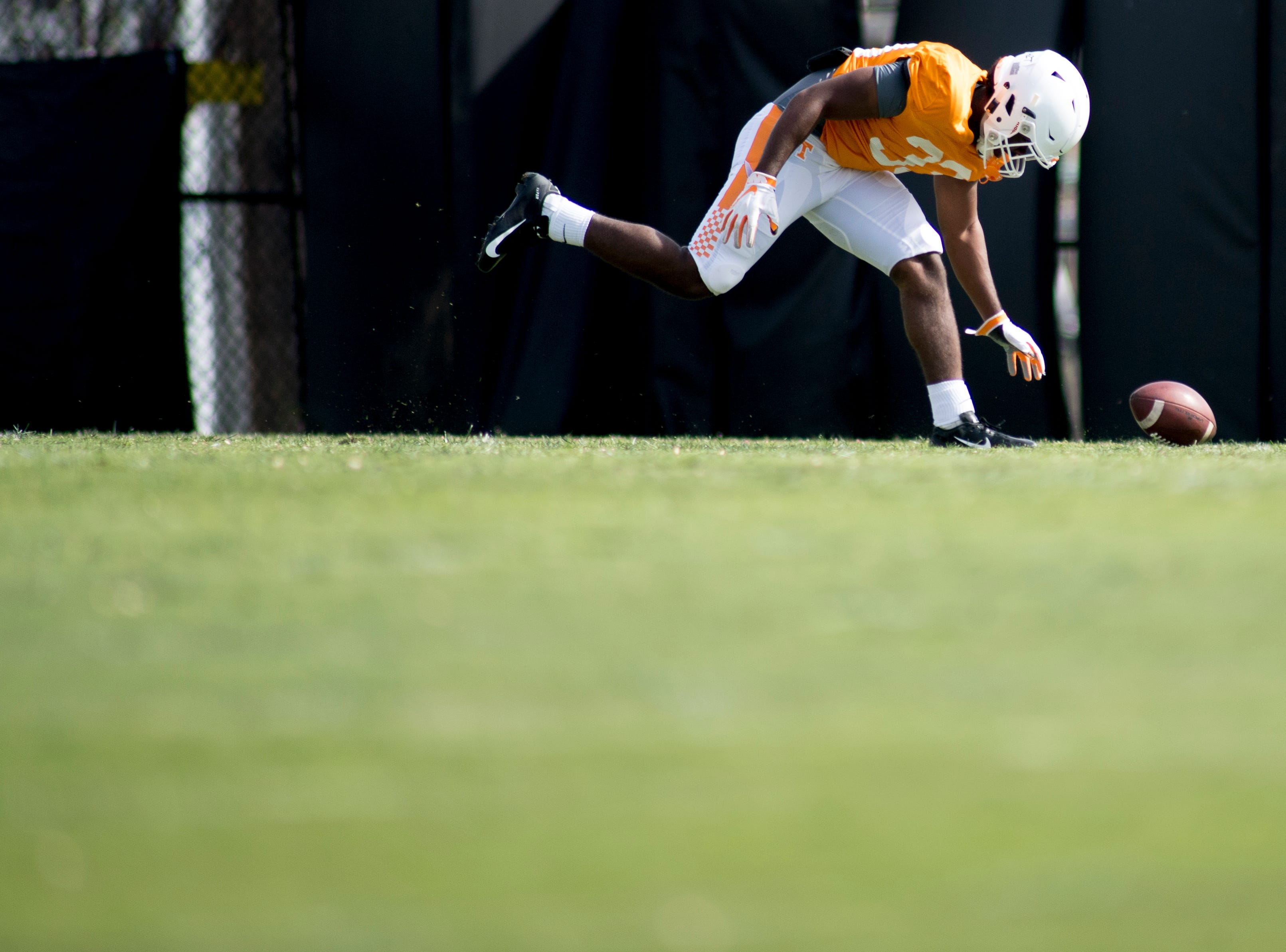 Tennessee's Jeremy Banks (33) misses the ball during Tennessee spring practice at Haslam Field in Knoxville, Tennessee on Thursday, April 11, 2019.