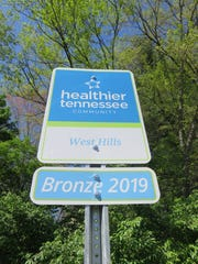 The new sign placed on Portsmouth Road designating West Hills as a Healthier Tennessee community.