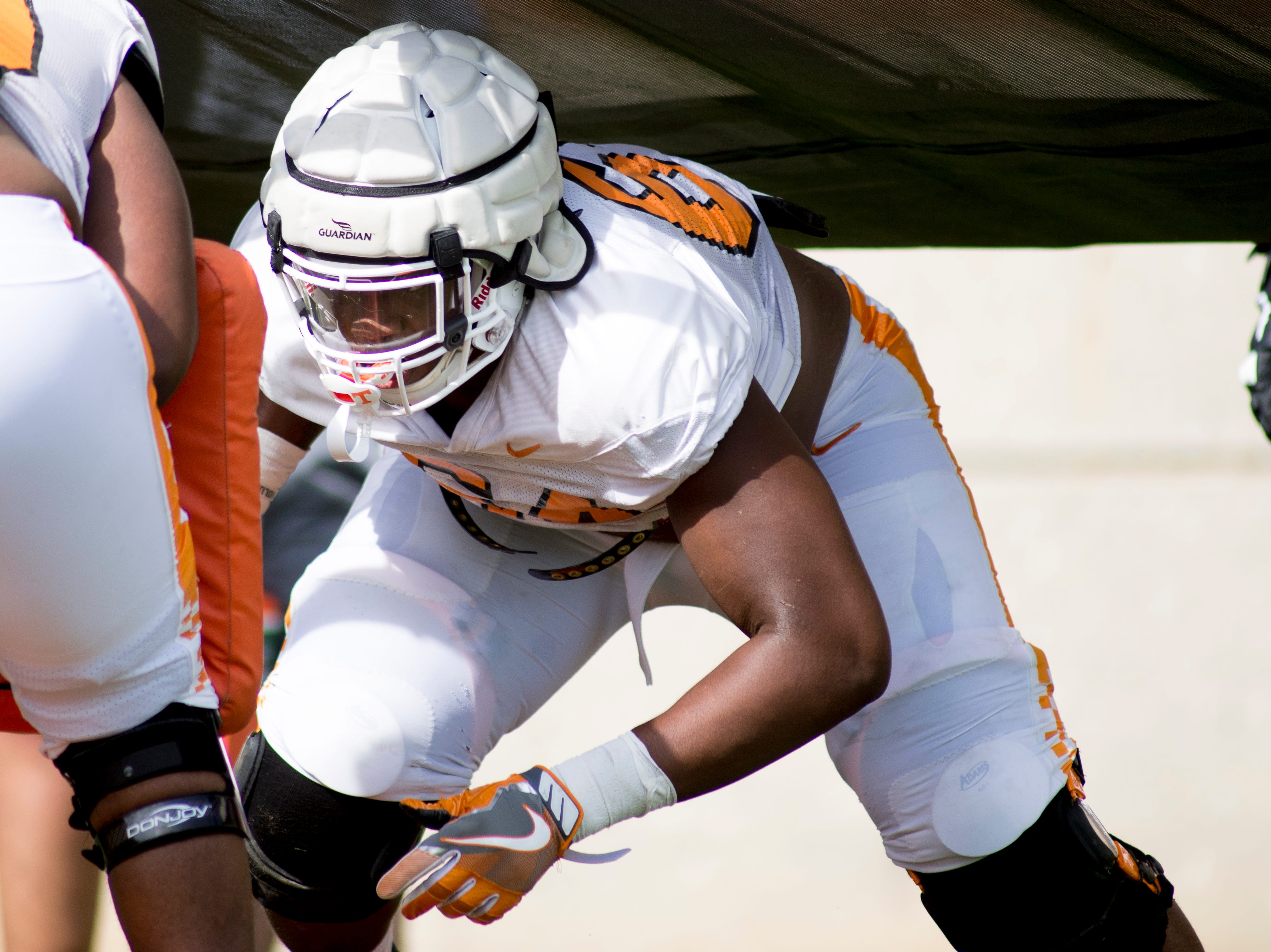 Tennessee's Wanya Morris (64) does a drill during Tennessee spring practice at Haslam Field in Knoxville, Tennessee on Thursday, April 11, 2019.