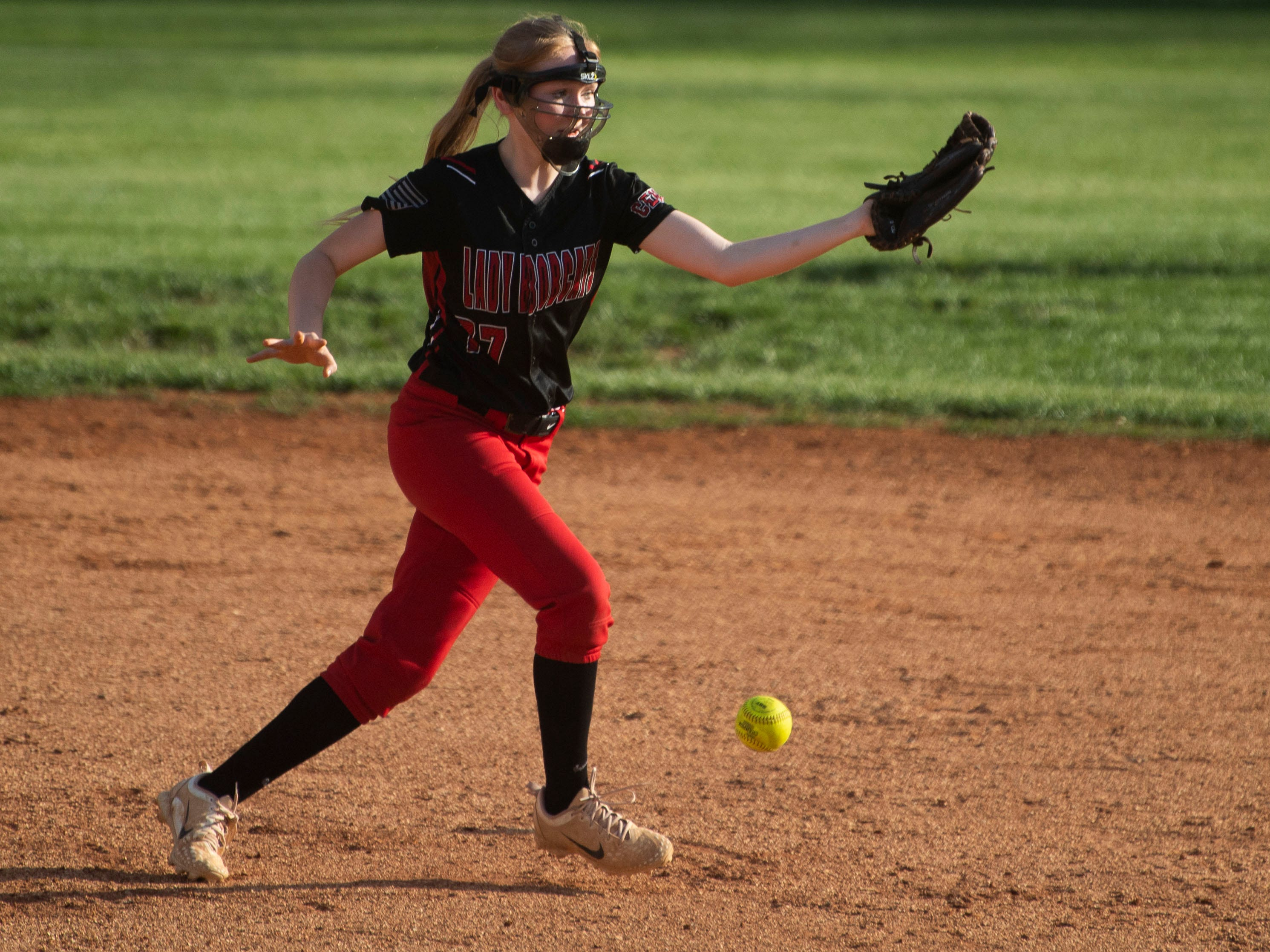The ball slips past Central's Taylor Kelly during the game at Powell on Thursday, April 11, 2019.
