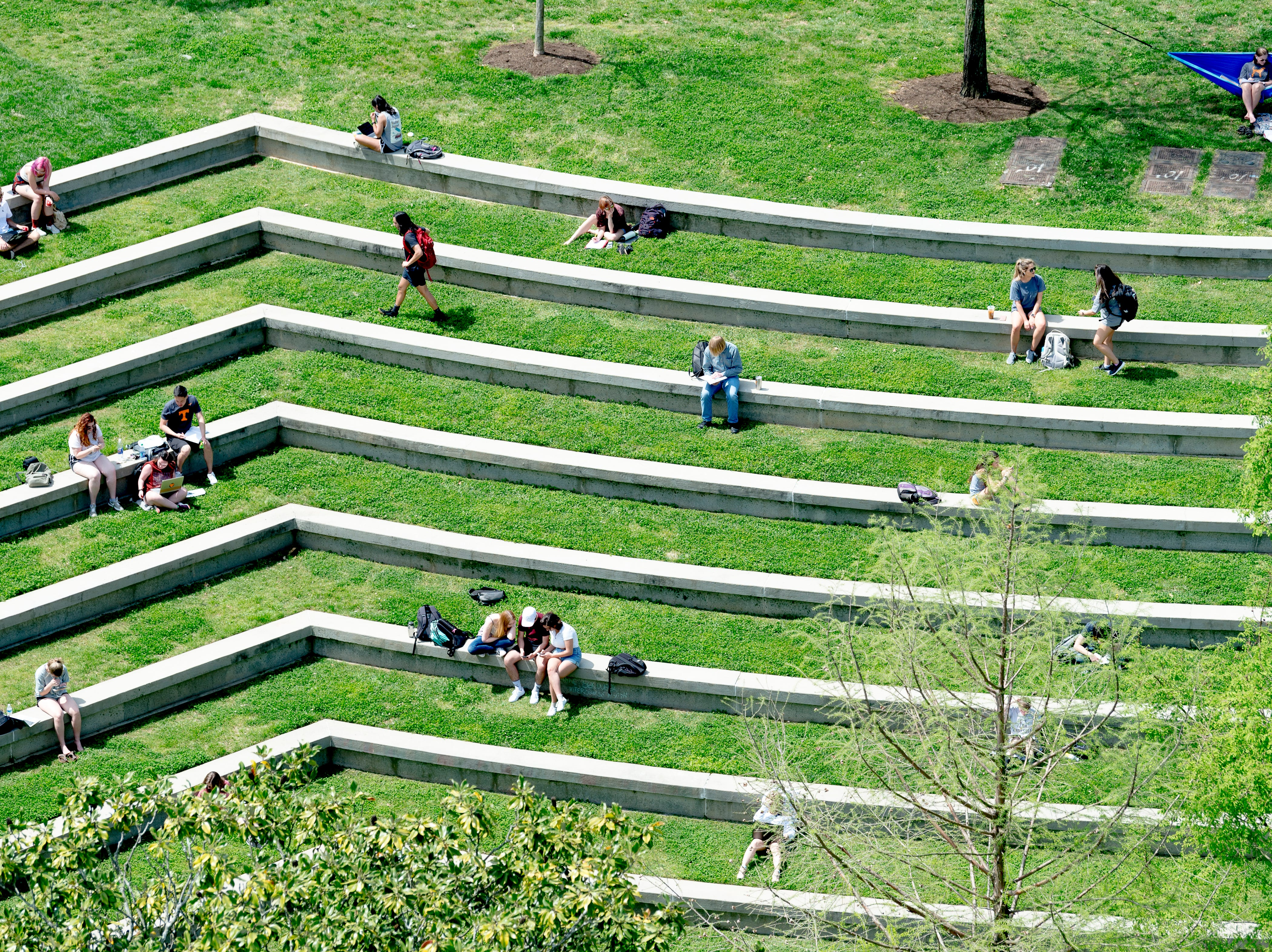 Students soak up some sun at the amphitheater in Knoxville, Tennessee on Thursday, April 11, 2019.